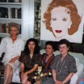 Not one to shy away from playing hostess, Ina and her guests from Thailand, pose with her portrait by Andy Warhol.
