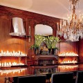 "An Empire-style chandelier and rows of candles illuminate the dining room. The custom stainless-steel Wing table ""is a contemporary touch to a classical room,"" says Richani, who designed it."